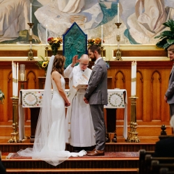 Bride and groom exchange vows during their wedding ceremony at St Peter's Catholic Church in Uptown Charlotte