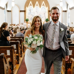 "Bride and groom are all smiles as they exit their wedding ceremony after saying "" I Do"" at St Peter's Catholic Church"