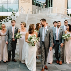 A fun bridal party is all smiles as they celebrate their marriage in Uptown Charlotte