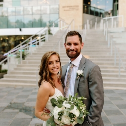 Bride poses with her groom while holding her stunning bouquet created by Lily Greenthumbs