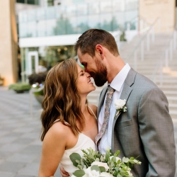 Bride and groom are all smiles in Uptown Charlotte during their wedding captured by Jordyn Schirripa Photography
