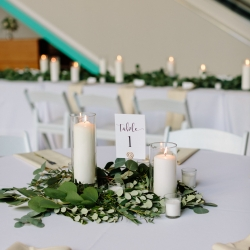 Crisp white linens and warm candle light are the perfect table settings for a fall wedding in Uptown Charlotte North Carolina