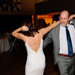 Bride dances with her father during her fall wedding reception coordinated by Magnificent Moments Weddings