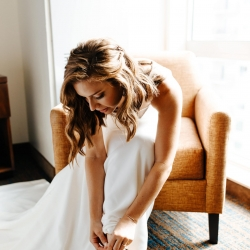 Bride complete the final details as she prepares for her Uptown Charlotte wedding