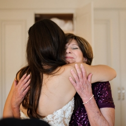 Bride shares a sweet moment with her mother before her Uptown Charlotte Wedding