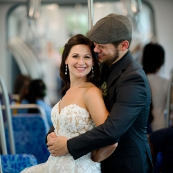 Julia Laible Photography captures a bride and groom on Charlotte's light rail as they prepare for their wedding ceremony at The Mint