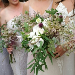 Sarah Grimshaw Designs crated stunning bouquets featuring lush green accents for a summer wedding at The Mint Museum Uptown
