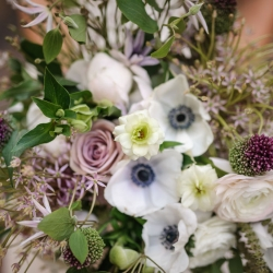 Bridal bouquet created by Sarah Grimshaw Design featured sunning florals and lush green accents