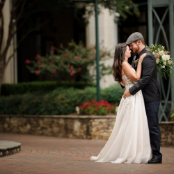 Bride and groom shared a sweet moment at The Green in Uptown Charlotte before their wedding for Julia Laible Photography