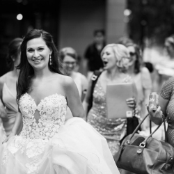 Bride is all smiles as she walks toward her wedding ceremony at The Mint Uptown coordinated by Magnificent Moments Weddings