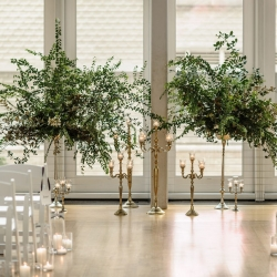 Stunning ceremony space featured large greenery accents at The Mint Museum Uptown