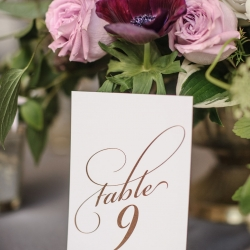 Simple table numbers showed off the couples style for a summer wedding coordinated by Magnificent Moments Weddings