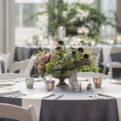 Greenery centerpieces created by Sarah Grimshaw Designs for a summer wedding at The Mint Museum Uptown