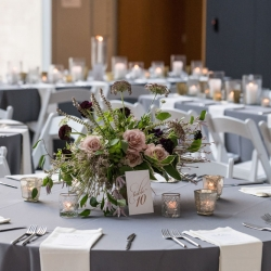 Lush green centerpieces created by Sarah Grimshaw designs were the perfect setting captured by Julia Liable Photography