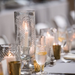 Antique glass vases and loads of candle light created a stunning look for a summer wedding at The Mint
