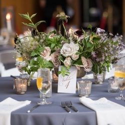 Amazing centerpieces by Sara Grimshaw Designs are the perfect touch to a summer wedding coordinated by Magnificent Moments Weddings