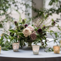Dark purples and green accents are the perfect centerpieces for a summer wedding at The Mint Museum Uptown