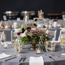 Cool gray linens and lush greenery centerpieces are the perfect touches for a summer wedding designed by Sarah Grimshaw Designs