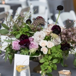 Stunning centerpieces of lush purples created by Sarah Grimshaw Designs for a summer wedding in Charlotte, North Carolina