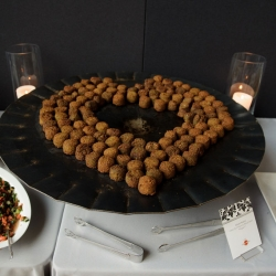 Something classic creates a heart during a wedding reception at The Mint Uptown