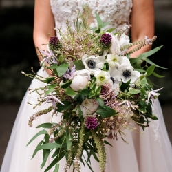 Stunning bridal bouquet features purple hues crated by Sarah Grimshaw Designs for a summer wedding at The Mint