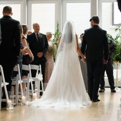 Groom escorts his bride the the altar during their summer wedding captured by Julia Laible Photography