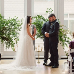 Bride and groom share vows they had written during their ceremony coordinated by Magnificent Moments Weddings