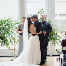 Bride and groom exchange a kiss after their vows all captured by Julia Laible Photography