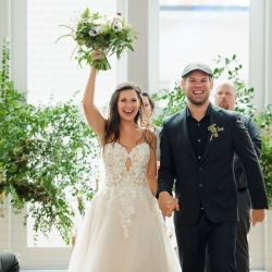 Bride and groom leave their ceremony after exchanging vows during their wedding coordinated by Magnificent Moments Weddings