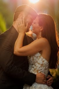 Julia Laible catches a bride and groom in the setting sun during their wedding at The Mint Museum Uptown