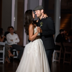 Bride and groom share a first dance to music by Hipshack during their uptown wedding coordinated by Magnificent Moments Weddings