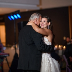 Bride shares a first dance with her father to music provided by Hipshack during her uptown Charlotte wedding