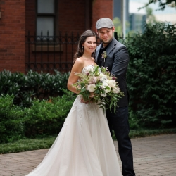 Bride and groom pose for Julia Laible Photography before their summer wedding in Uptown, Charlotte North Carolina