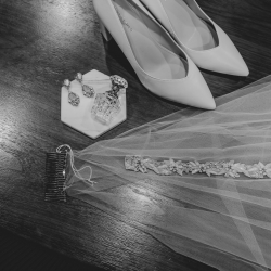 Brides veil and shows are the perfect accessories for Kelly Meyers Photography to capture during a summer wedding at The Mint Museum Uptown