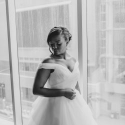 Bride poses for Kelly Meyers Photography showing off her stunning hair by Tracy Riggs Salon and make up by Monica Nicole Beauty