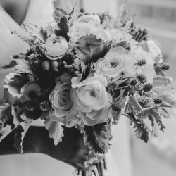 Stunning bridal bouquet feature white roses and greenery accents by April's Floral Expressions