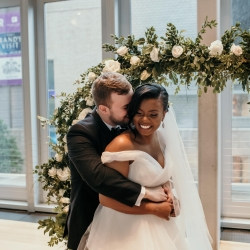 Bride and groom are all smiles after exchanging vows during their summer wedding at The Mint