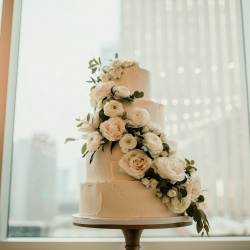 Stunning cake be Sky's the Limit features soft pink flowers from April's Floral Expression for a summer wedding at The Mint