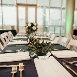 Stunning details of greenery and gold created the perfect centerpieces designed by April's Floral Expressions for a summer wedding at The Mint