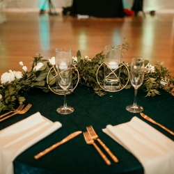 Sweethear table featured green line from Party Reflection and a greenery centerpiece designed by April's Floral Expressions