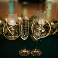 Custom champagne flutes were the perfect addition to a sweetheart table designed by April's Floral Expressions