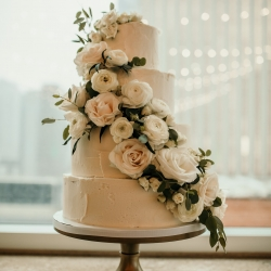 Sky's the Limit created a stunning four tier white cake for a wedding in Uptown Charlotte