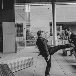 Kelly Meyers Photography captures fun between a groom and his groomsmen as they prepare for their summer wedding