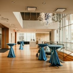 Cocktail tables covered in teal linens from Party Reflections created the perfect setting for a summer cocktail hour at The Mint
