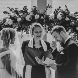 Bride and groom exchange vows during their wedding ceremony captured by Kelly Meyers Photography