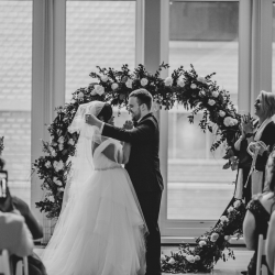 Groom prepares to kiss his bride during a wedding ceremony at The Min coordinated by Magnificent Moments Weddings