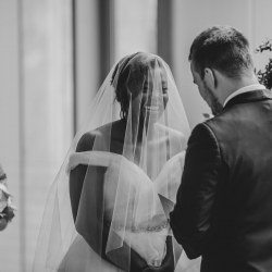 Bride and groom share a laugh during their wedding ceremony captured by Kelly Meyers Photography