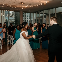 Bride and groom share a dance during their wedding reception at The Mint Uptown captured by Kelly Meyers Photography