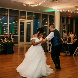 Bride dances with her dad to music provided by Operation Make the Bride Happy during her wedding reception coordinated by Magnificent Moments Weddings