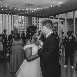 Bride and groom share a first dance to music provided by Operation Make the Bride Happy during their wedding reception at The Mint Uptown